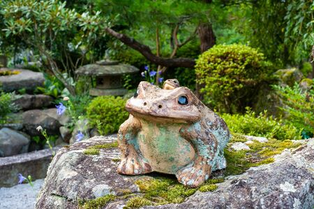Frog figurine placed in Japanese style garden Stok Fotoğraf