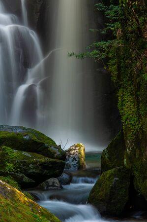 Waterfall flows and spotlights 版權商用圖片