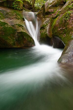 Beautiful water flow in a small waterfall