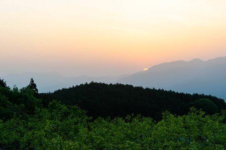 Asahi rising from Nara vineyard and mountain 写真素材