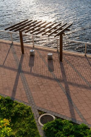 Long shadow of evening with sea and chair