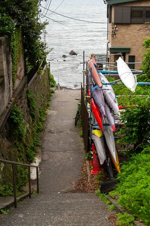 Downhill and rowing boats leading to the sea