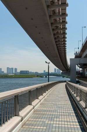 Suspension bridge in Tokyo Bay divided into sidewalk and railway