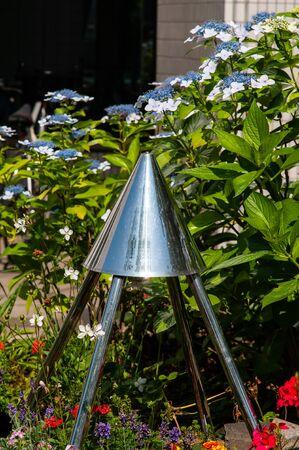 Hydrangea flower and triangular pyramid metal