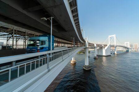 A huge suspension bridge in Tokyo Bay where trucks pass 写真素材