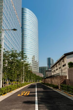 Blue sky, skyscrapers and paved road