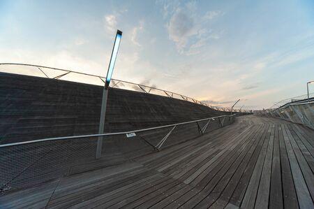 Yokohama at dusk and funny shaped wooden path and streetlight