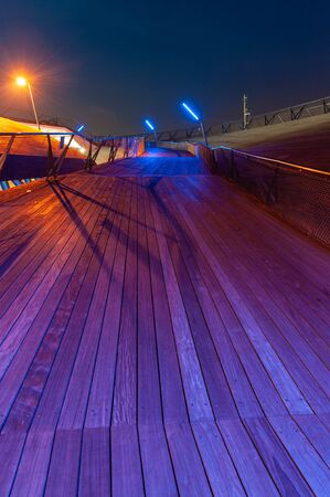 A wooden road in Yokohama with colorful lighting