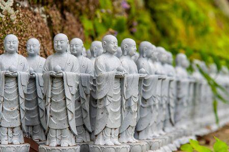 Many stone statues arranged neatly 写真素材