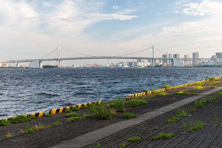 A huge suspension bridge in Tokyo Bay as seen from the wharf 写真素材