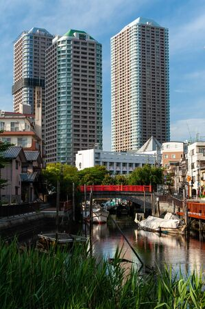 Blue sky and old fishing port and modern building 写真素材