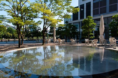 Reflections on the water surface of buildings and trees 写真素材