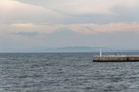 Mt. Fuji seen over the ocean