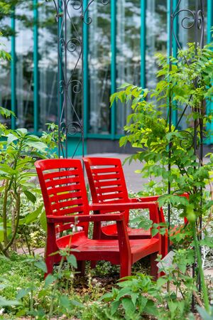 Red chairs installed in the garden