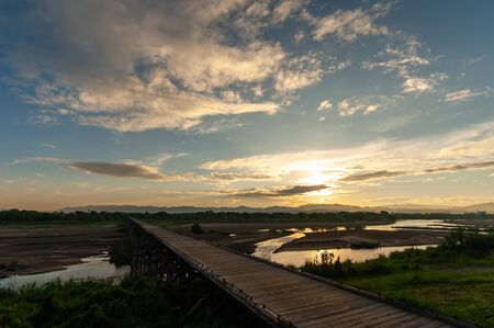 Wooden bridge over the river in Kyoto and the morning sun