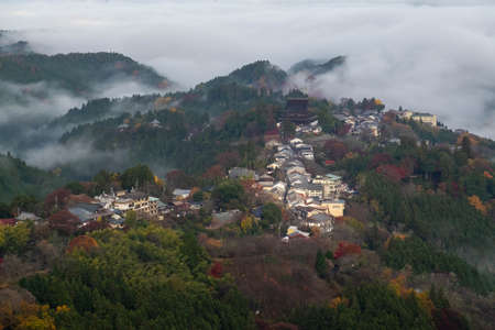 Morning mist and mountainside towns 写真素材