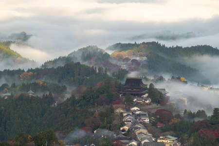 A beautiful mountain town in the morning mist 写真素材