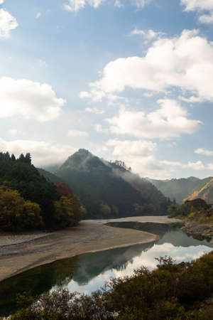 Mountains, rivers and blue skies in the morning mist 写真素材