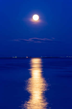 Full moon's reflection in the sea