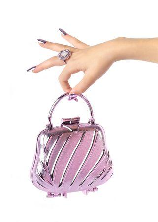 beautiful hand holding evening handbag