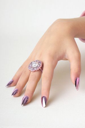 beautiful hand with false shining nails
