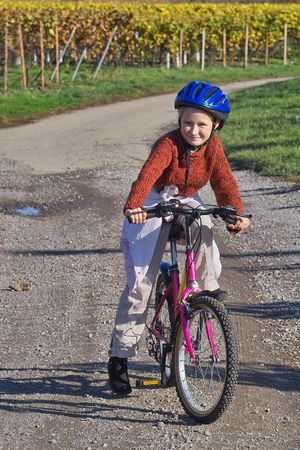 girl ridding her bicycle in the wineyards