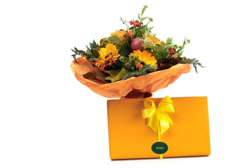 beautiful bouquet in orange gamma with a box of chocolates Stock Photo