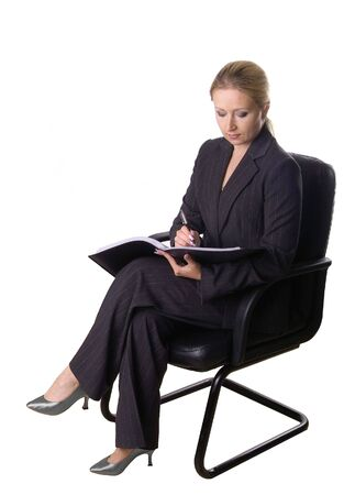 congenial: Business woman sitting in the armchair Stock Photo
