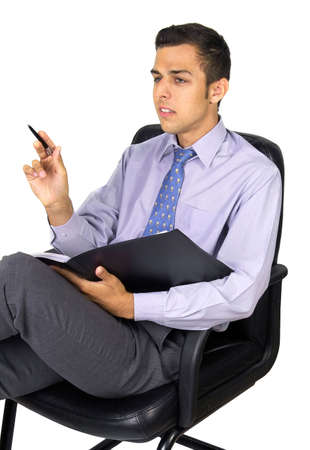 Business man in the armchair with notepad and pen photo