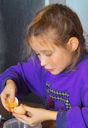 licking finger: little girl cooking