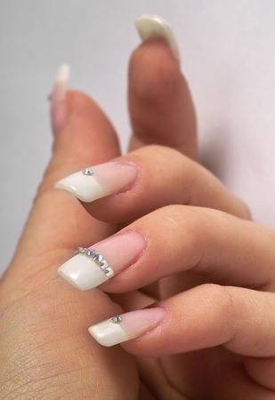 french model: beautiful hands with french manicure and diamonds