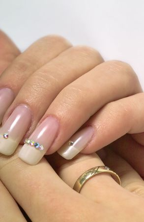 beautiful hands with french manicure and diamonds