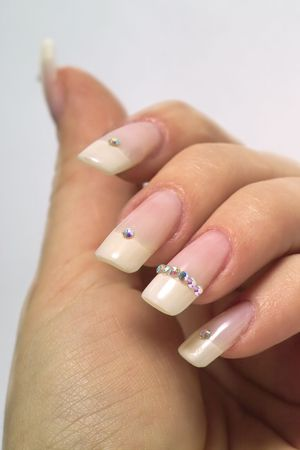rhinestones: beautiful hands with french manicure and diamonds