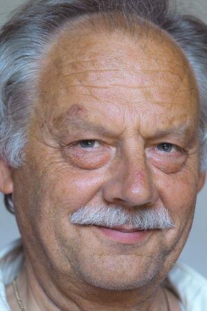 wistful: old man smilling