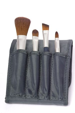 isoliert: travelling set of four make up brushes with mirror