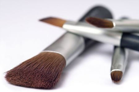 travelling set of four make up brushes with mirror