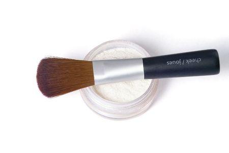 make up brush laying over glittering powder Stock Photo
