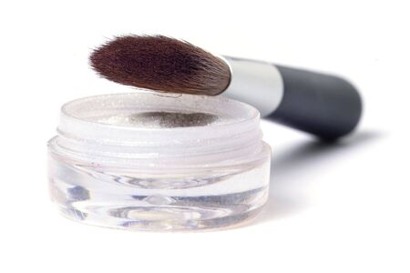 beauty brush and glittering powder