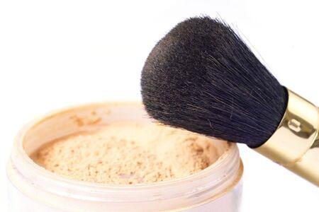 loose powder and natural hair brush