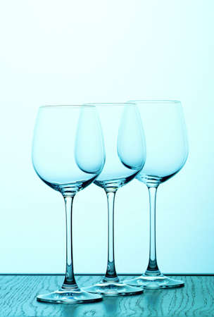 isoliert: three wine glasses in  blue backlight