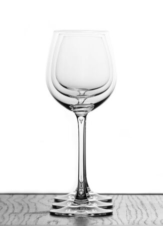 three wine glasses in backlight in one row Stock Photo