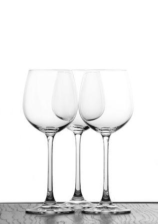 three wine glasses in backlight