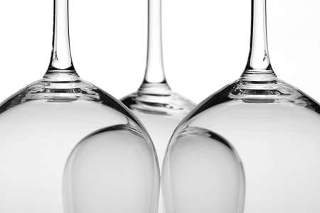 three wine glasses in backlight close-up Stock Photo