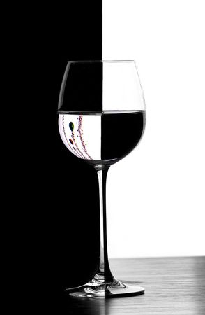 domino wine glasses in backlight on the black and white contrast background with christmas decoration
