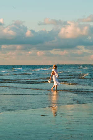 attractive blond girl at the seaside with seagulls Stock Photo - 1328862