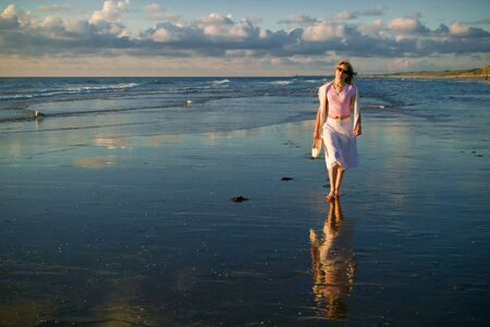 attractive blond girl at the seaside Stock Photo - 1328876