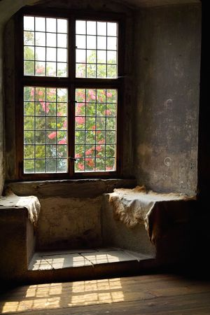old catle window with the look to the garden Stock Photo