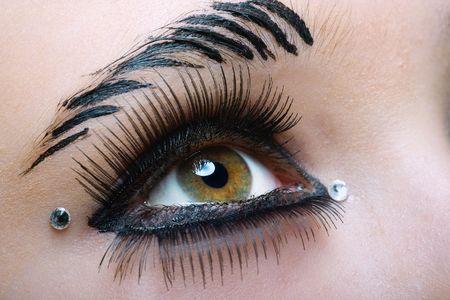 closeup of a black makeup with fake eyelashes