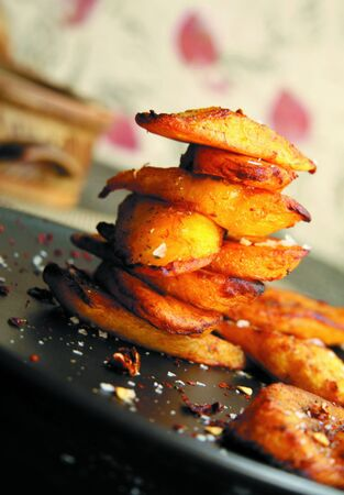 Stack of plantain chips on plate at unusual angle photo