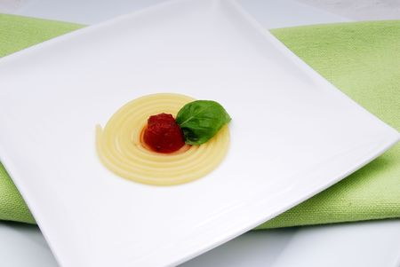 arranged: Noodles with tomato sauce.